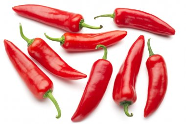 group of red chilies on white background