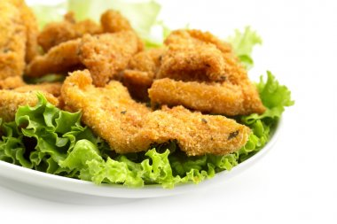 Detail of a dish of fried chicken on lettuce