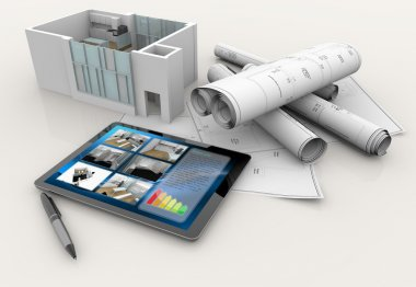 House model, blueprints, tablet and pen