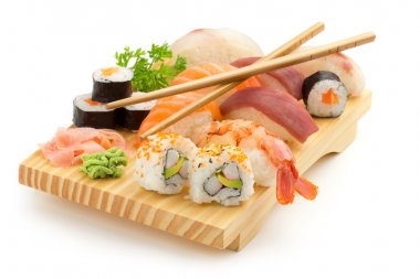 Japanese seafood sushi and chopsticks on wooden plate