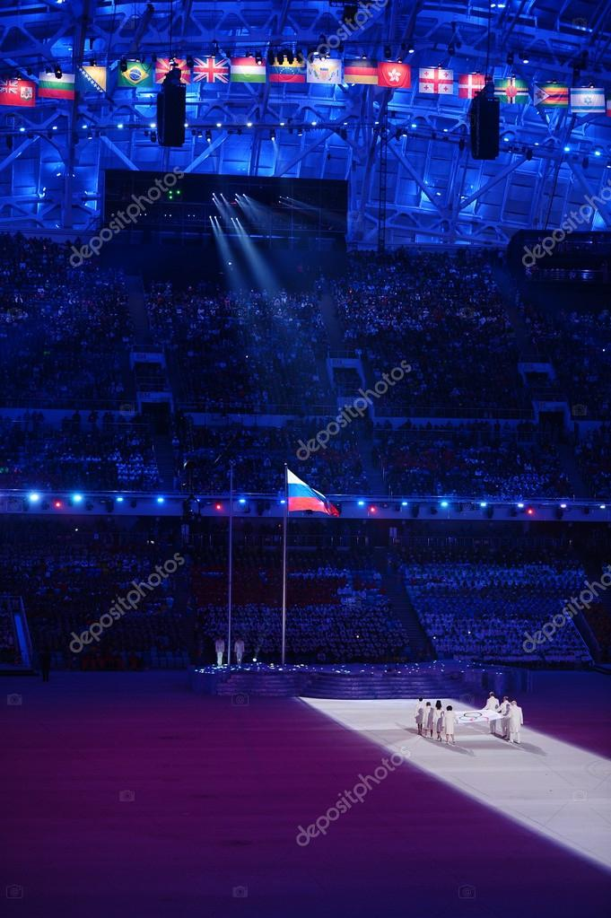 Sochi, RUSSIA February 7, 2014: Opening ceremony of Sochi 2014 XXII Olympic Winter Games.Olympic flag bearers Chulpan Khamatova, Lidiya Skoblikova,Anastasia Popova, Valentina Tereshkova,Vyacheslav Fetisov,Valery Gergiev, Alan Enileev,Nikita Mikhalkov