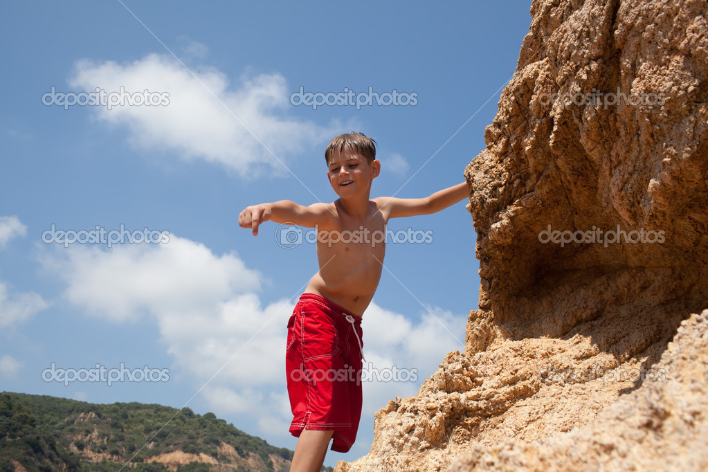 Little boy climbing up