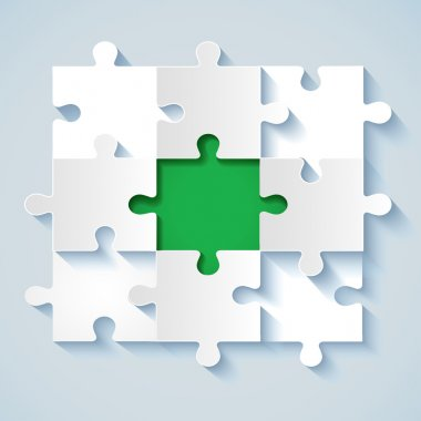 Paper puzzle with green the middle for business concepts