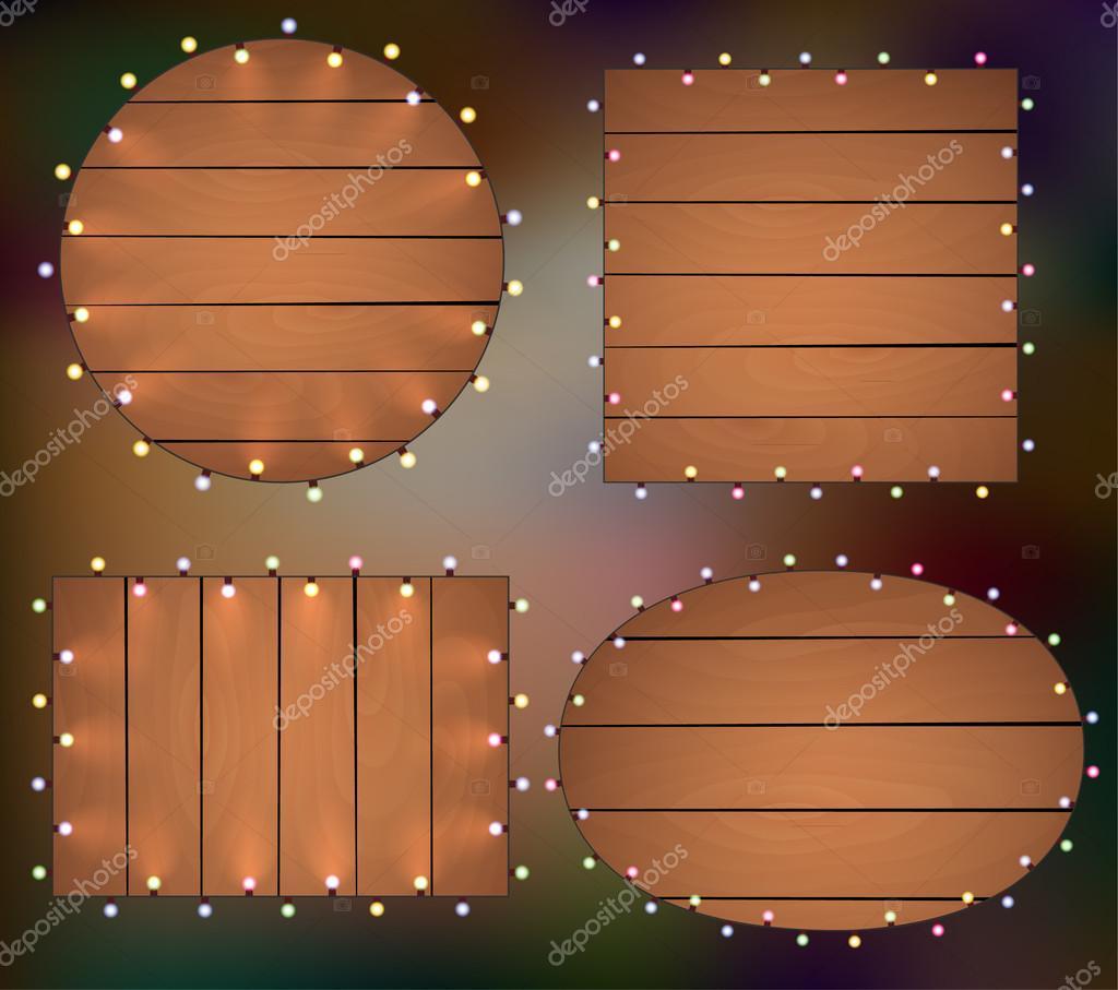 luces de Navidad sobre fondo de madera, marco con guirnaldas ...