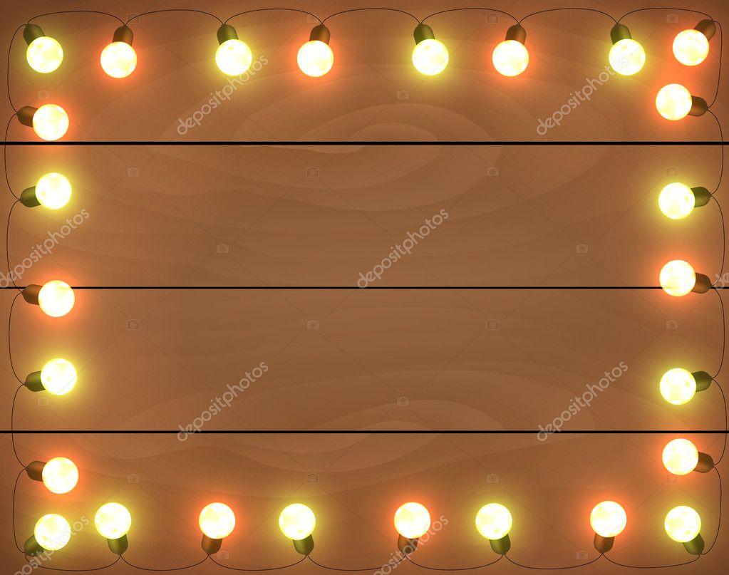 luces de Navidad sobre fondo de madera, marco con guirnaldas, hori ...