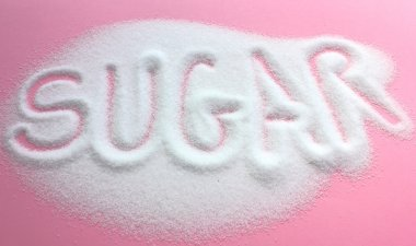 Sugar written in granulated sugar pile