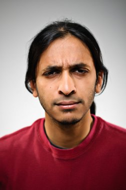 Young Indian Ethnic Man Squinting In Displeasure