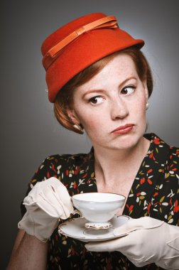 Retro Woman Passing Judgment While Drinking Tea