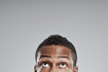 African American Man Eyes Only Looking Up