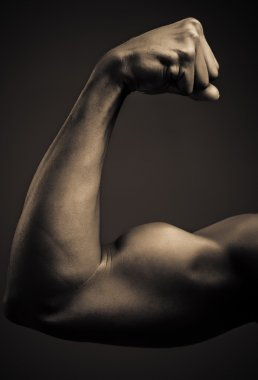 Young African American Man Flexing Biceps