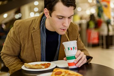 Drinking Soda with Pizza