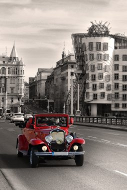 Vintage Car and dancing house in Prague
