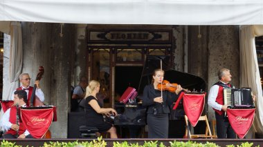 VENICE August 25. Musicians on the terrace of the world famous C