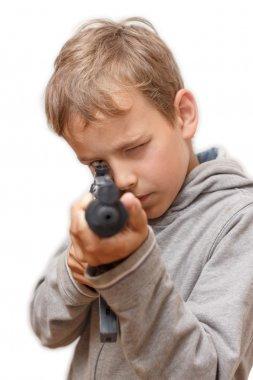 Boy plays with gun.
