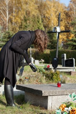 Widow at graveyard in fall