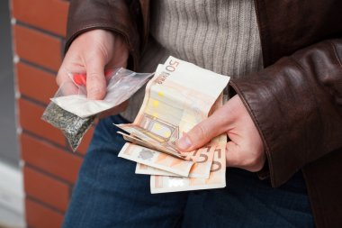 Drug dealer counting money
