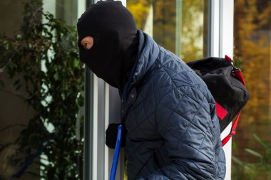 Burglar looking inside to house