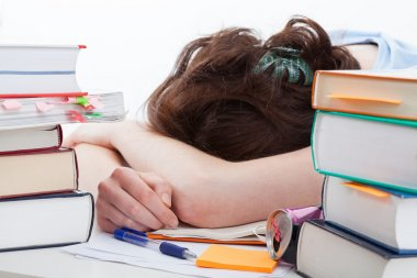 Tired student falling asleep during learning