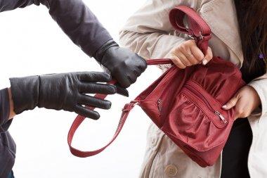 Thief holding a bag