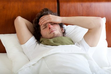 Man having cold in bed