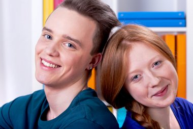 Two young people smiling