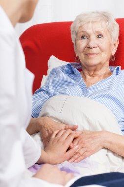 Nurse visiting senior patient