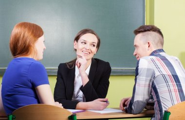 Students talking with teacher