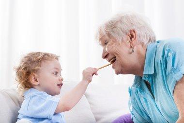 Grandson and grandma eating together