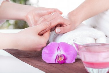 Lady during hand massage
