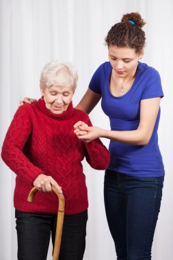 Nurse helping elderly lady walk