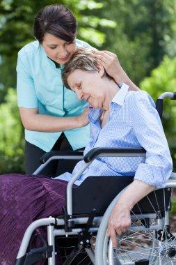 Nurse hugging woman