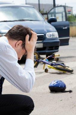 Sad man after hitting little biker