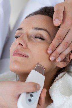 Close-up of woman having cavitation peeling