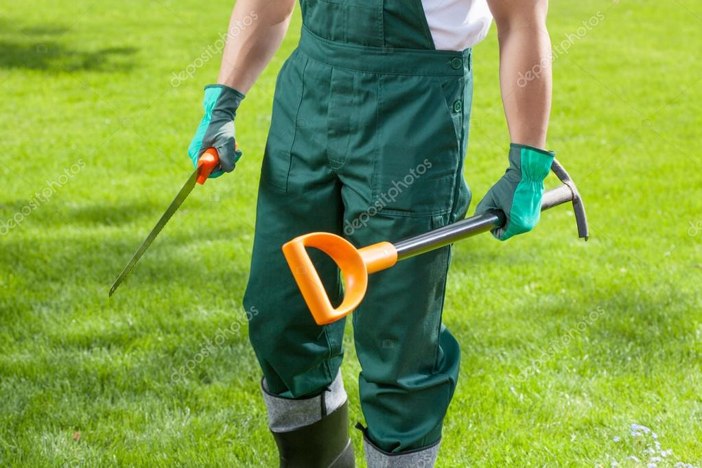 Gardener's hands with garden tools