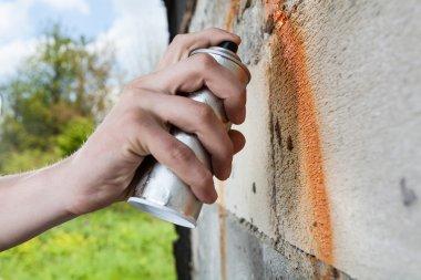 Hand holding graffiti spray