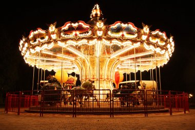 Carousel (Merry-Go-Round) illuminated at night. The picture was taken near Paris, France