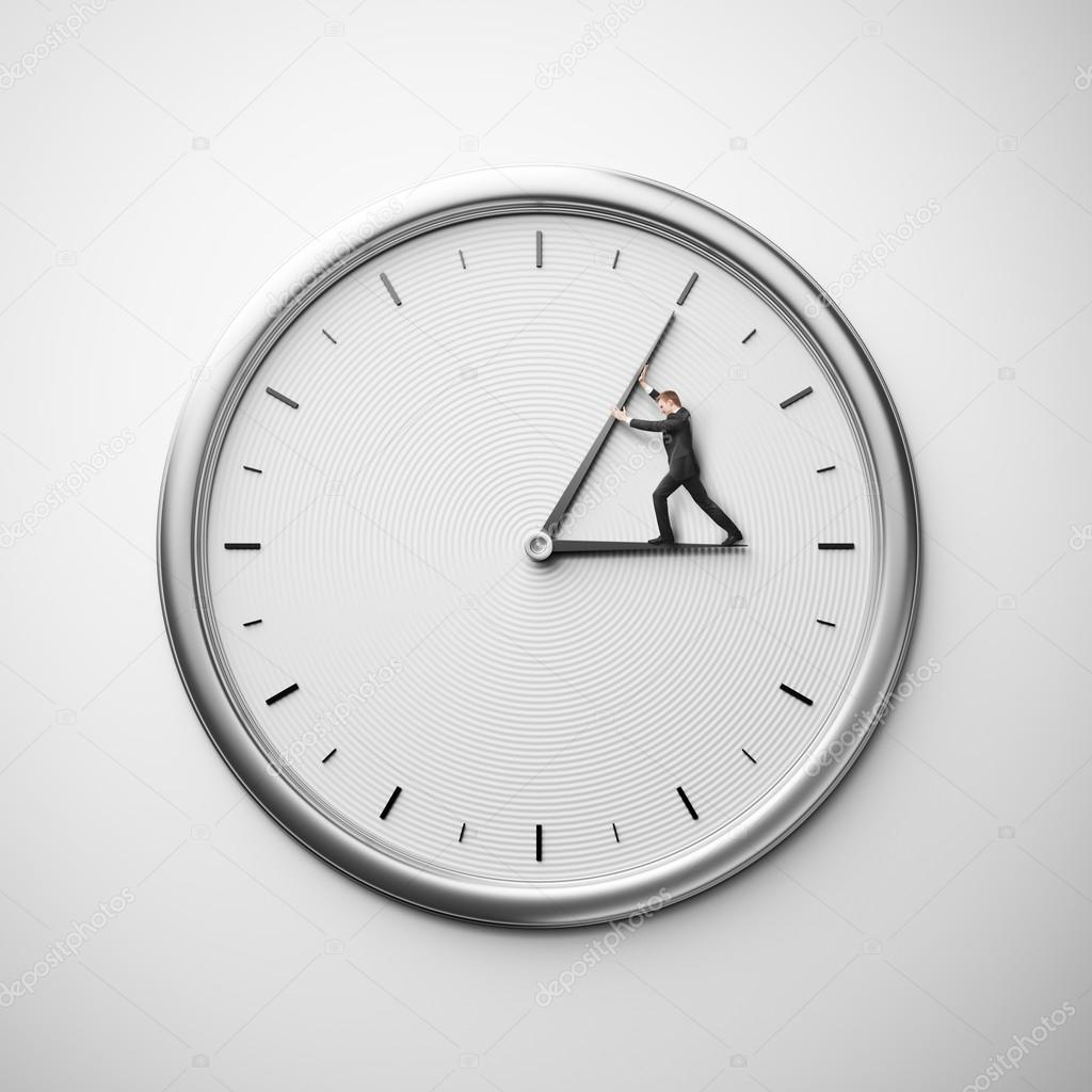 clock on the wall with businessman trying to stop time