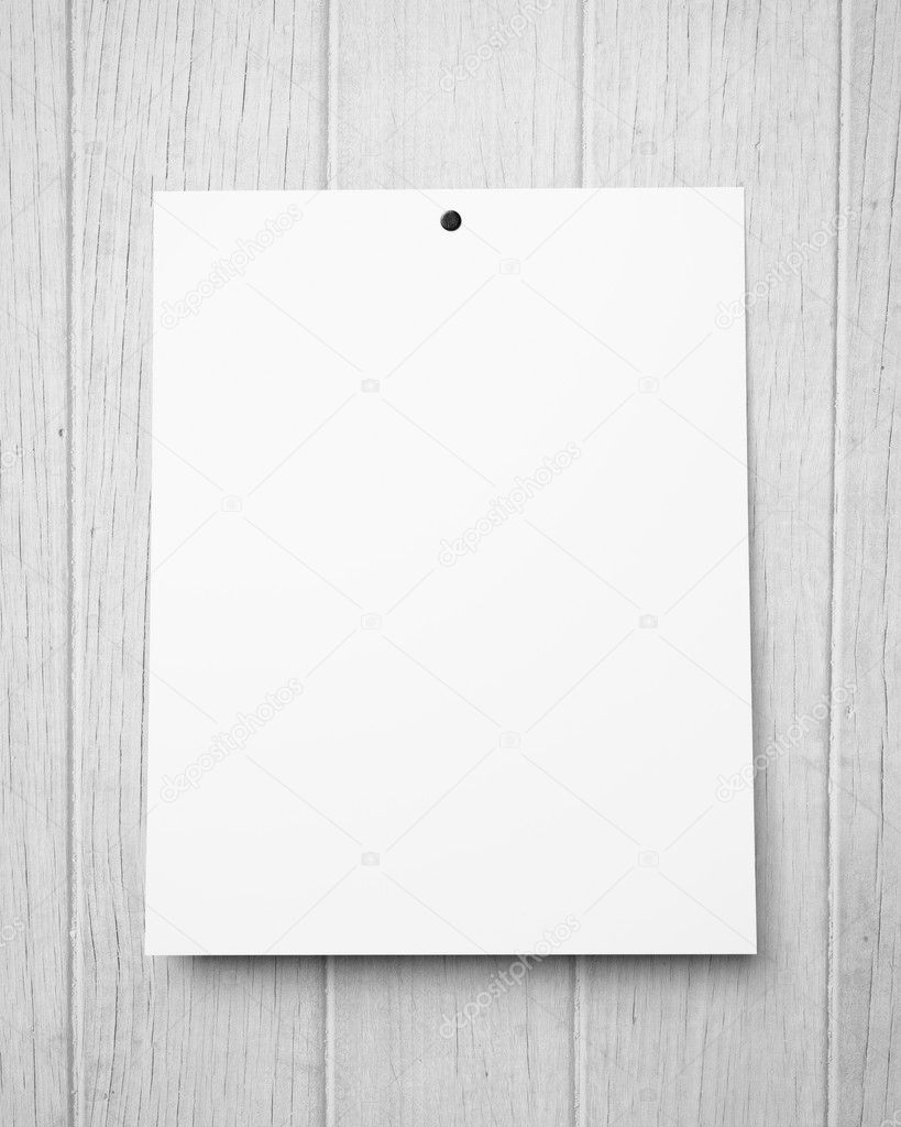 blank poster on a wood wall