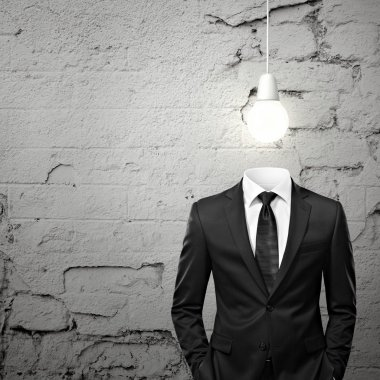 Man without head and with bulb above