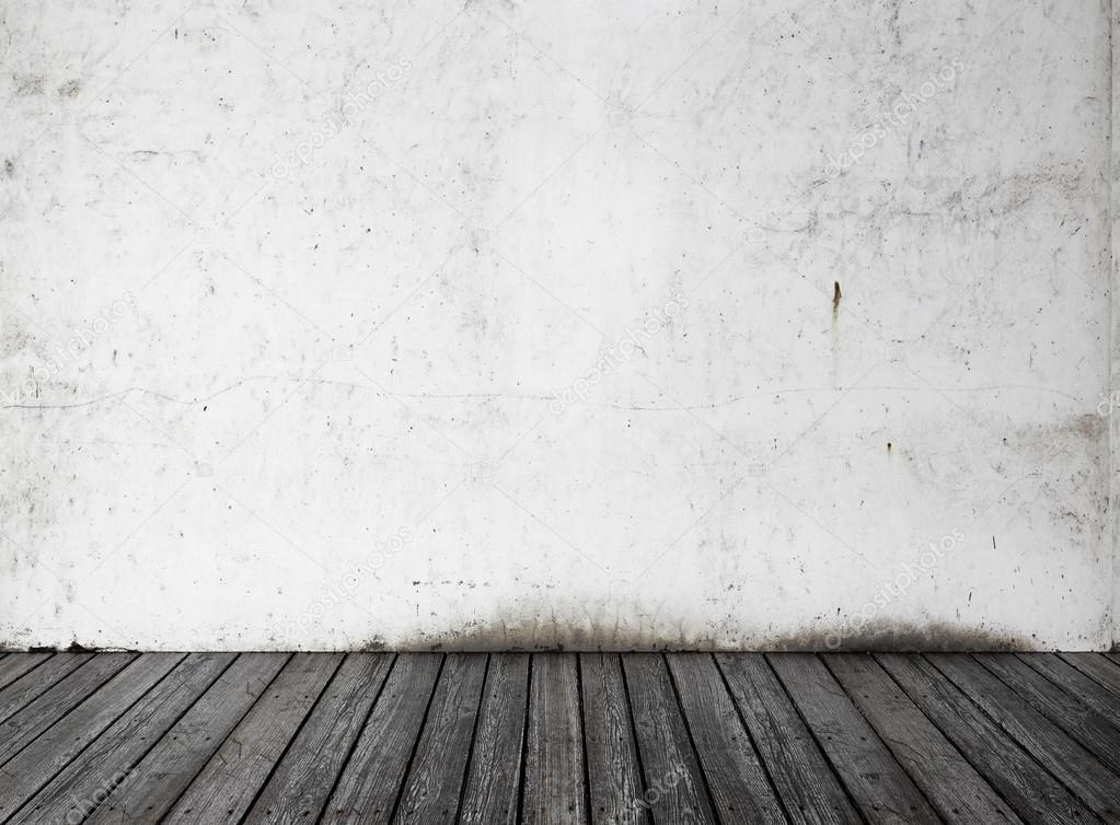 Witte muur en zwarte houten vloer u stockfoto kantver