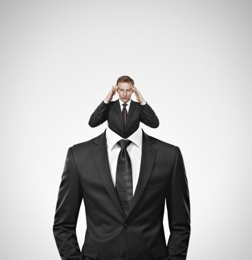 Thinking businessman is seen from others businessman neck