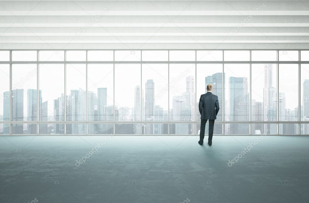 Bright office and businessman
