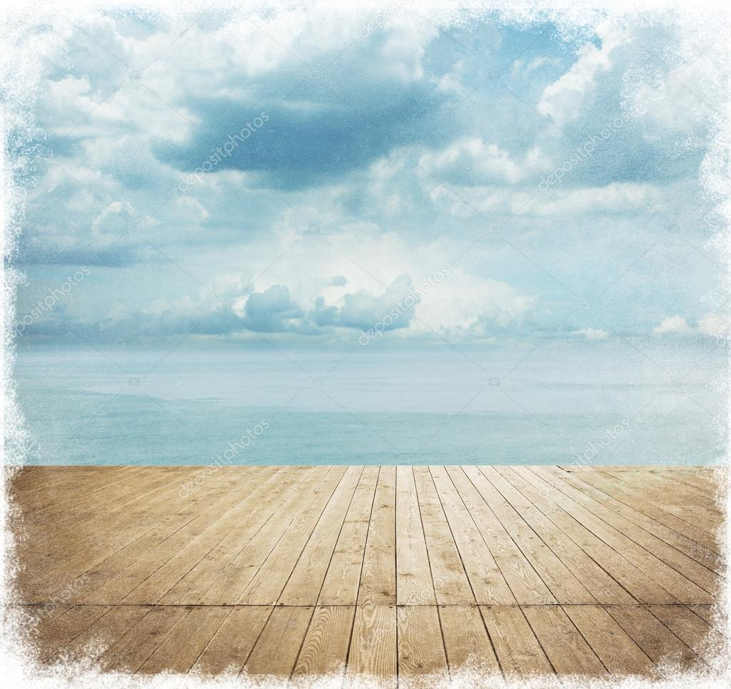 Wooden planks with cloudy sky