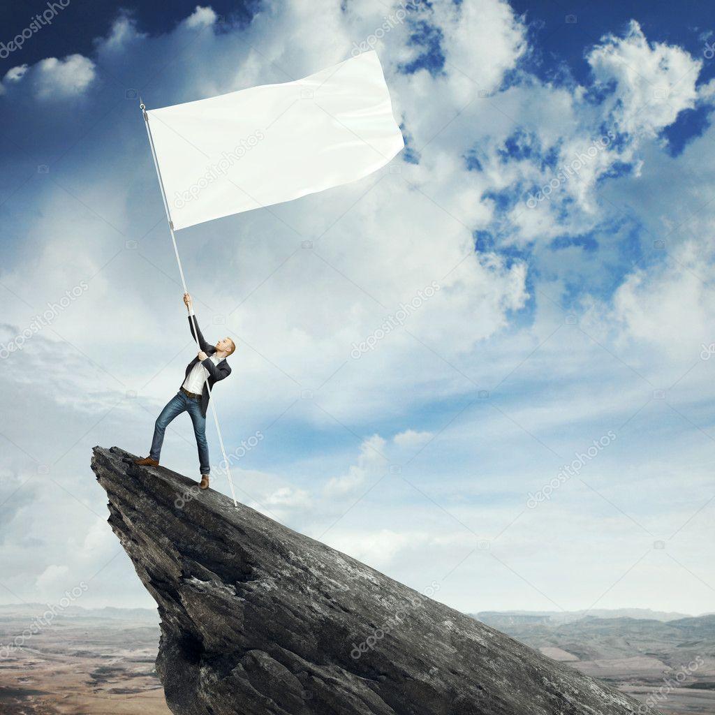 Man with flag on a peak