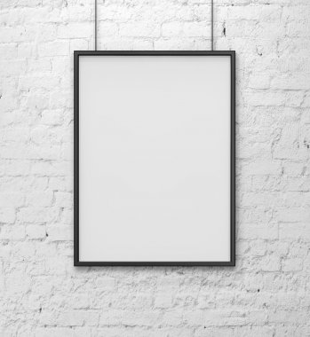 Blank frame on white brick wall