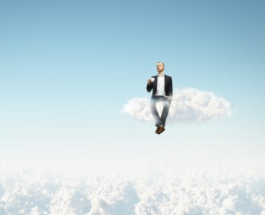 Man on a cloud with cup of coffee