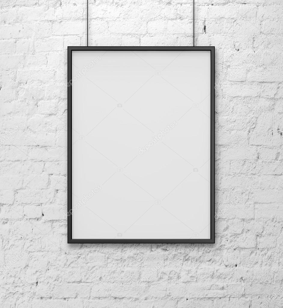 Blank frame on white brick wall