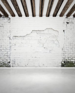 Damaged brick wall and concrete floor