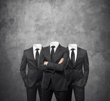 Group of businessmen without heads on concrete background stock vector