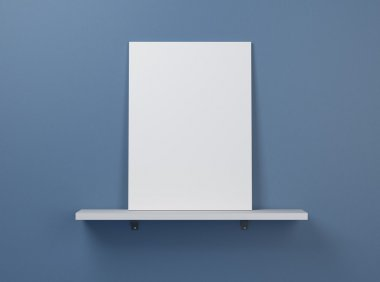 Blank poster on a shelf